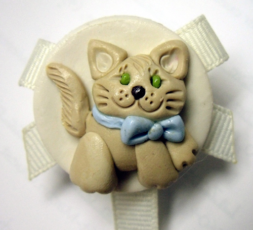 *CAT* pacifier holder, cream ribbon