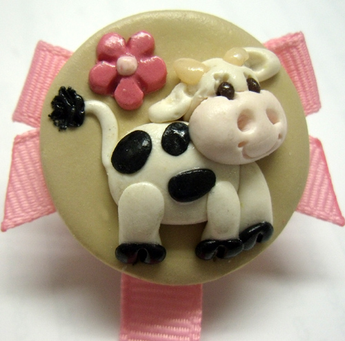 *COW* pacifier holder, pink ribbon