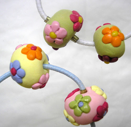 *FLOWERS* on pastel hair elastics